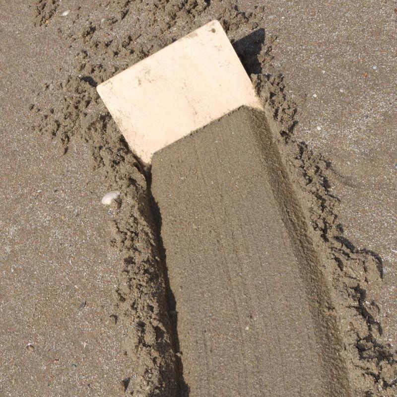 resultaat van zandkam die een wegmaakt