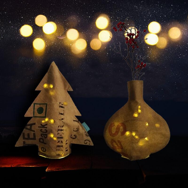 sfeerbeeld met flesvaas gevuld met lichtjes